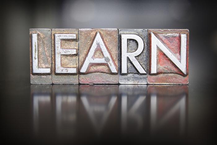 The word LEARN written in vintage lead letterpress type